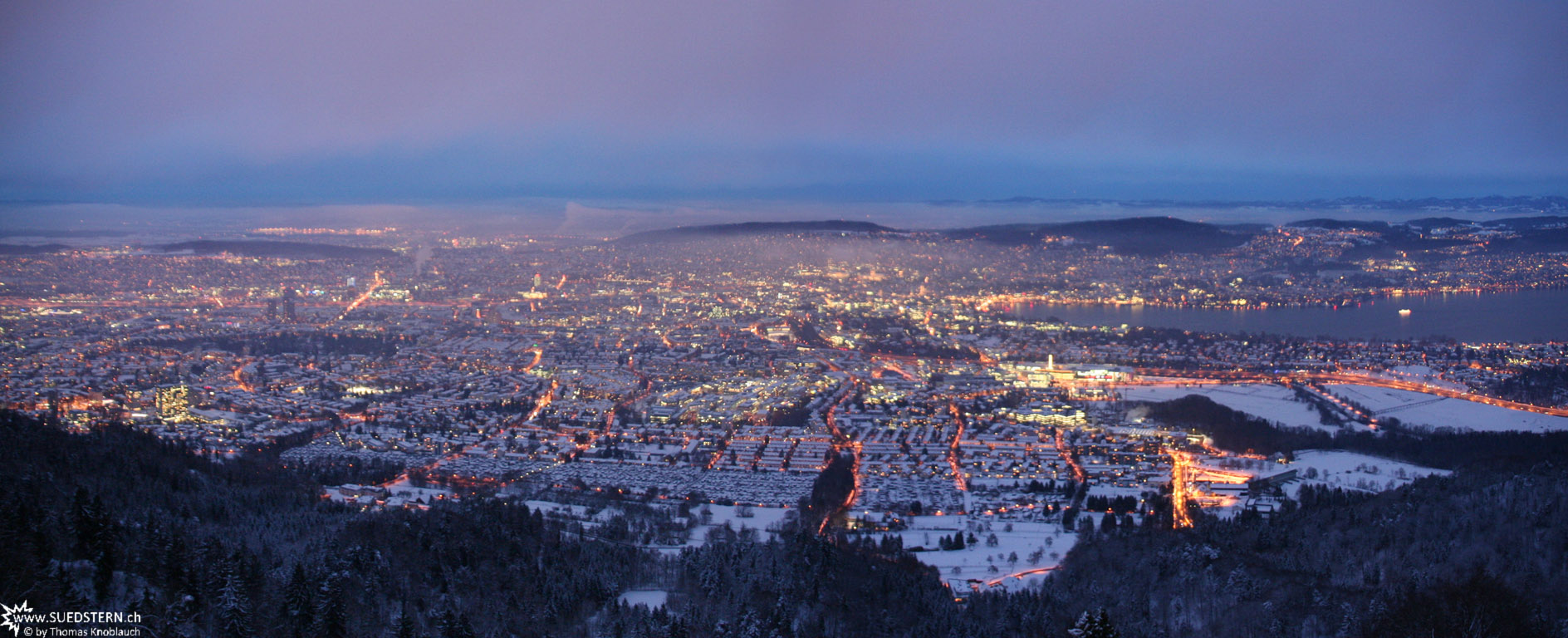 Panorama of Zuerich at the beginning of a winters night